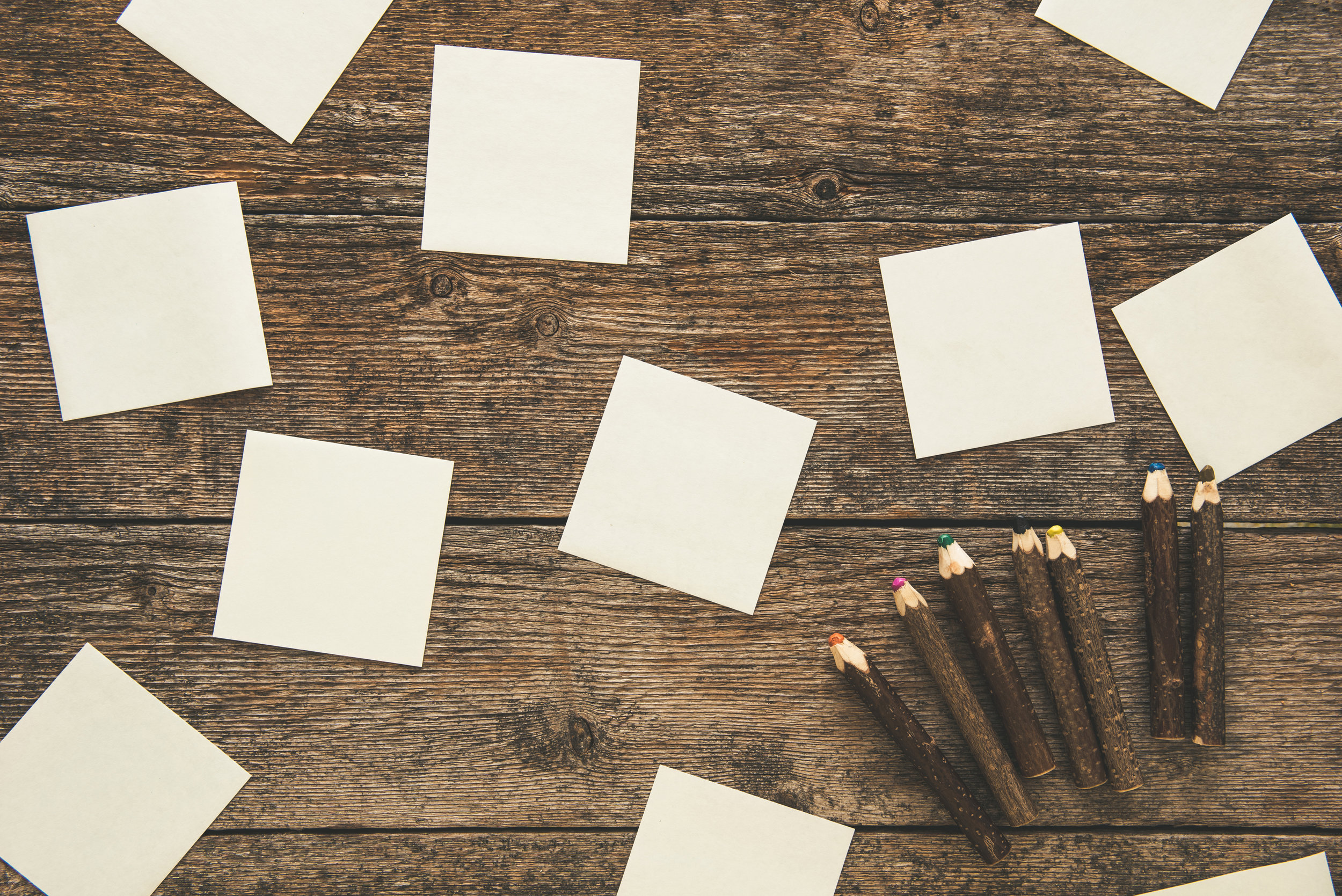 white-sticky-notes-and-set-of-colored-pencils-on-3PBUV68.jpg