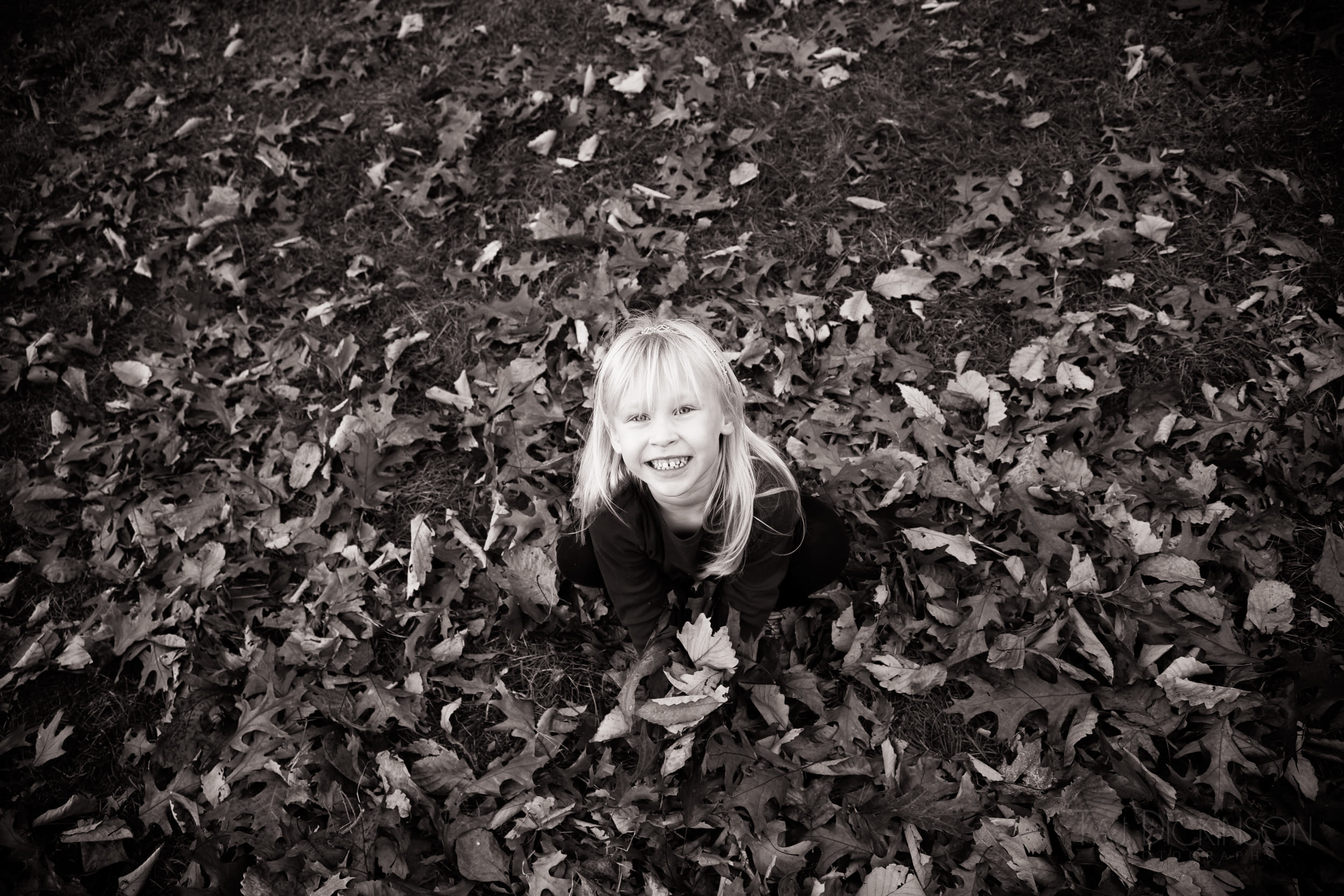 child portrait outdoors leaves