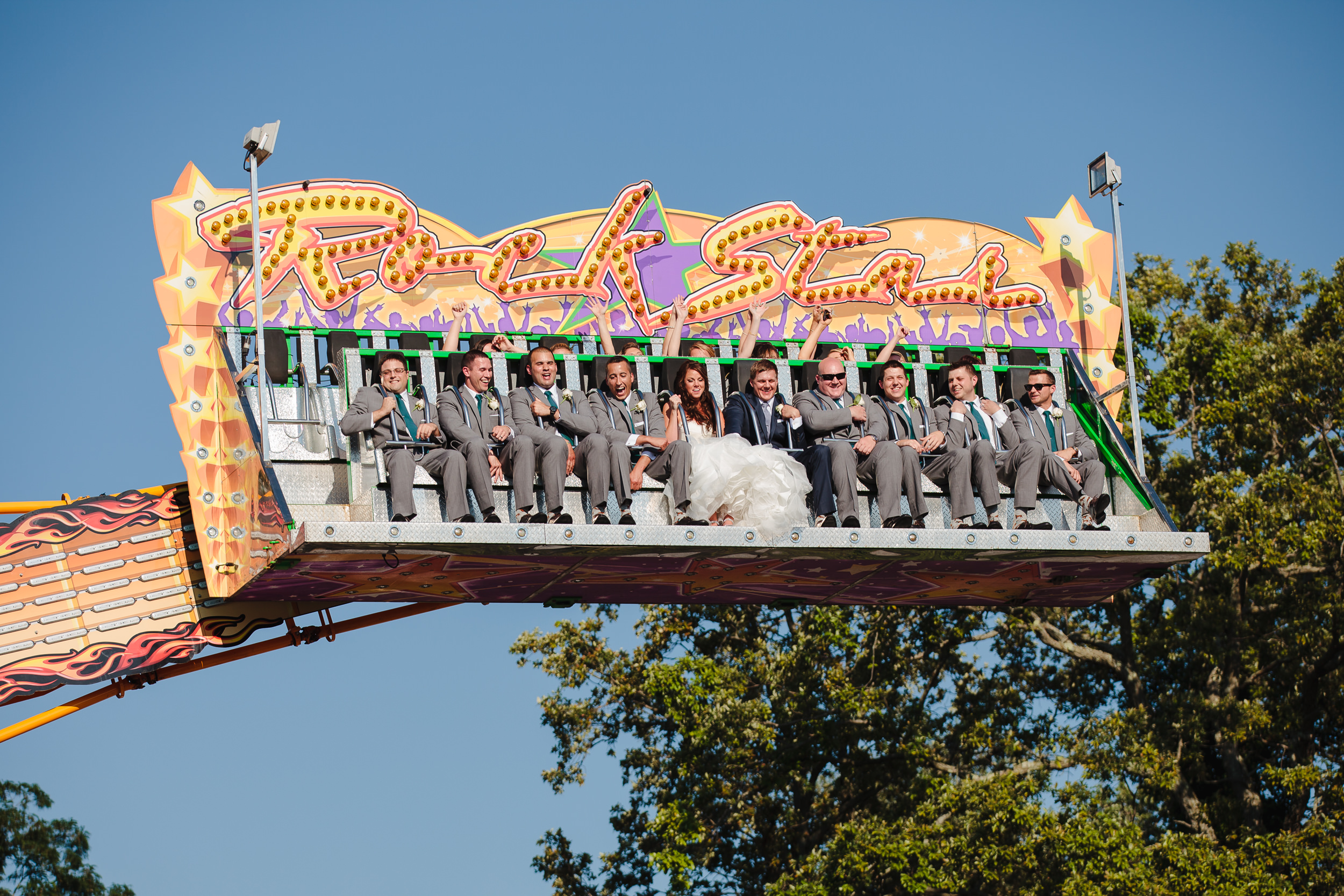 wedding party carnival ride group shot portrait