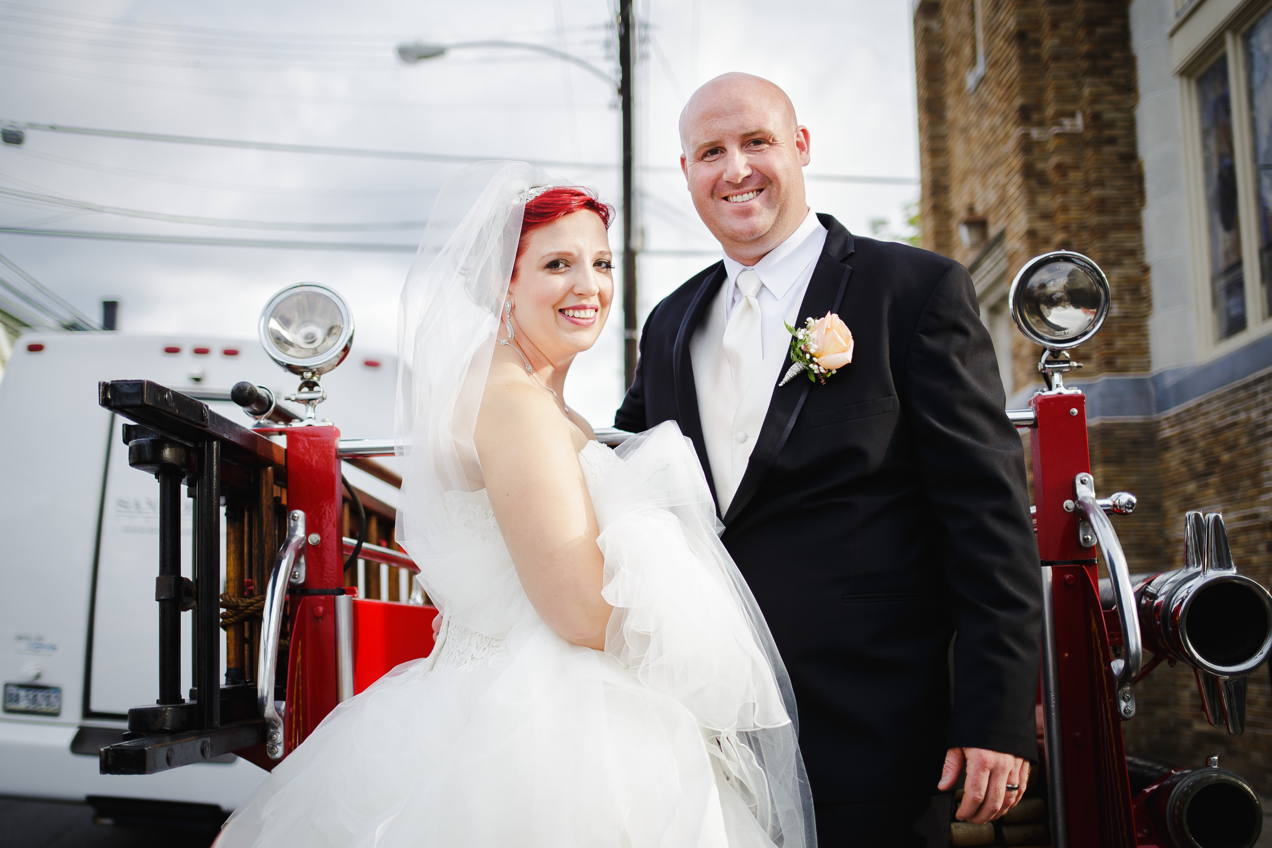 wedding portrait bride groom fire truck