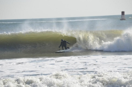 Surfing at First Street Jetty in Virginia Beach (photo by Juice Box Surf).
