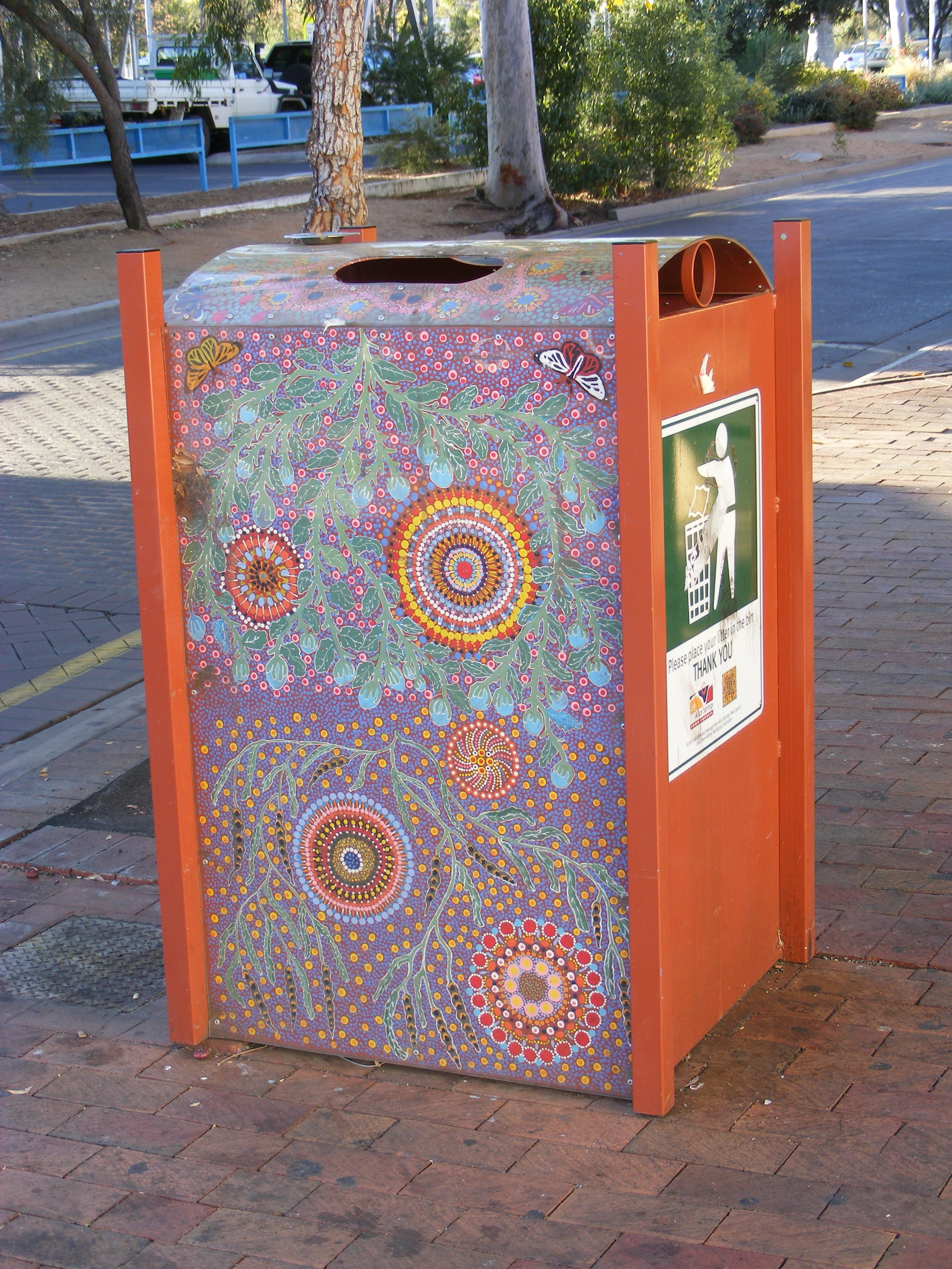 Even the trash cans are decorated in Aboriginal art.