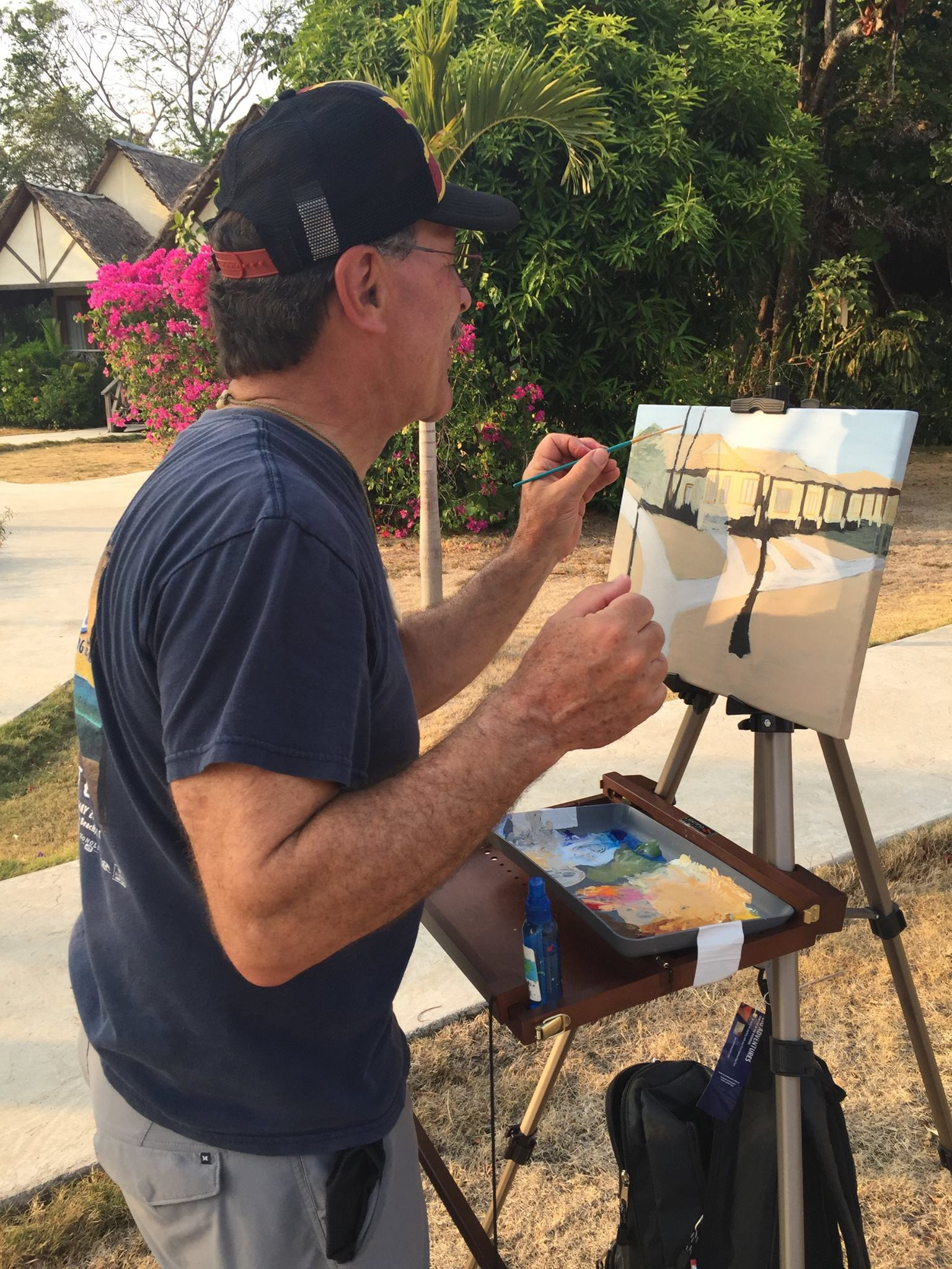 Always working! Taping down the palette is wise in high winds. The water bottle mister keeps my acrylics moist.