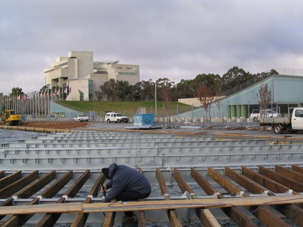 Installing the joists with the High Court in the background