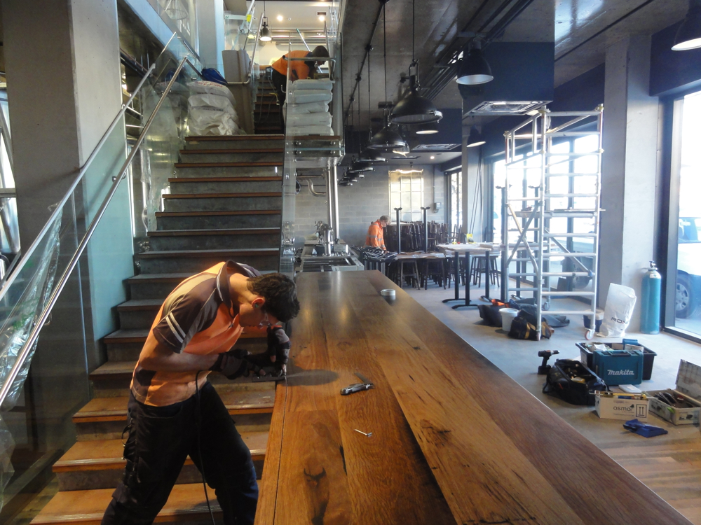 Sam cutting in the 5 meter bar top during install