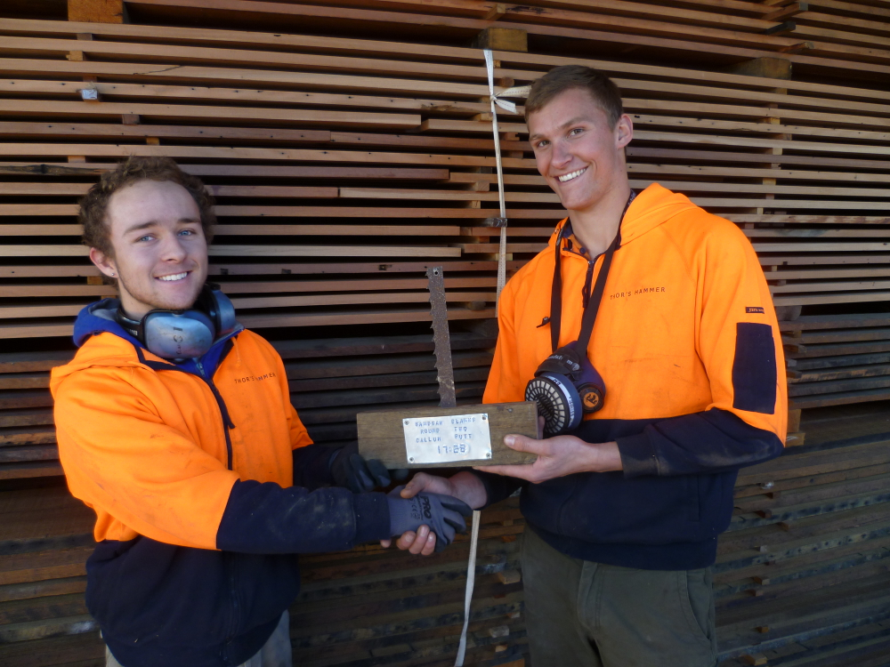 Our timber machinist and bandsaw operator Ewald Bouwer handing over the Bandsaw Award to the new champion Callum Putt!