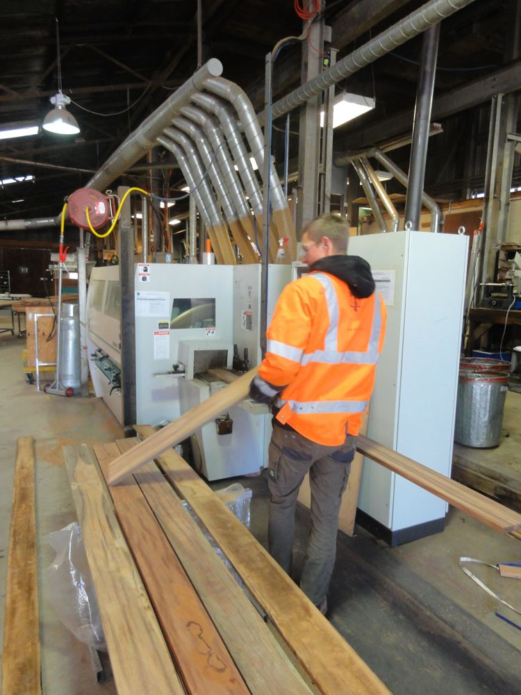 Floor board blanks about to be passed through the moulding machine to have tounge and groove profiles added
