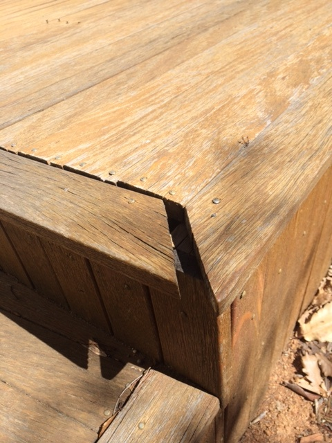 An example of decking boards being laid too close together, they have taken on moisture and swollen, pushing the outside board and opening up the mitre joint.  Once again would have looked great when it was installed but only a few years later it needs replacing.