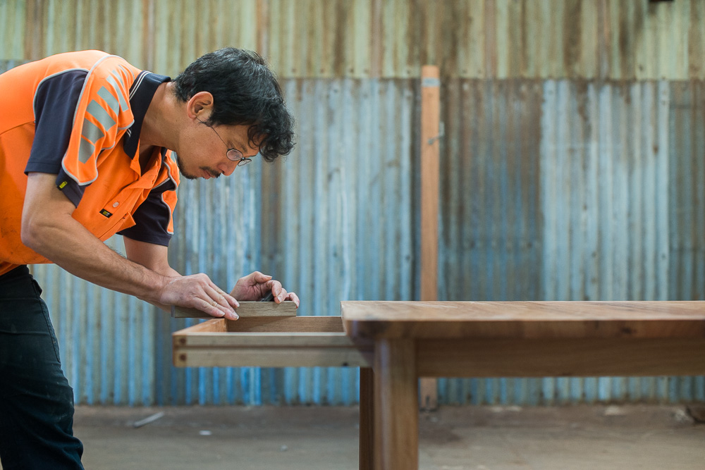 Hiroshi Yamaguchi, one of our senior craftsmen using the Kanna, or wooden Japanese plane.