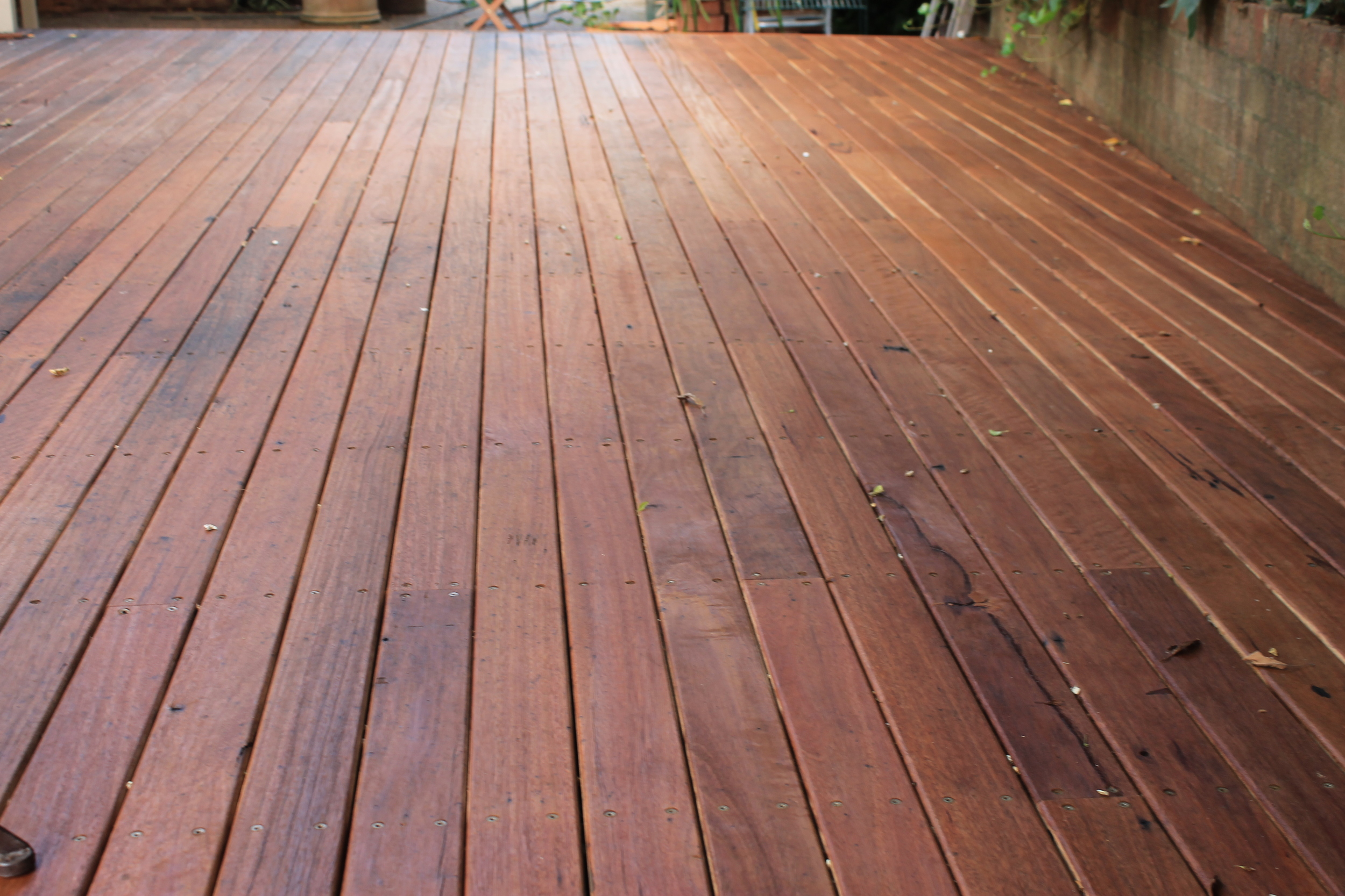Rustic Decking made from salvaged house rafters