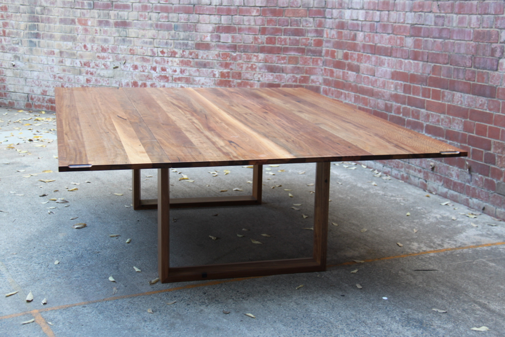 Folding leaf table custom built for Amelia Witheridge fully expanded, seating for 14 people.