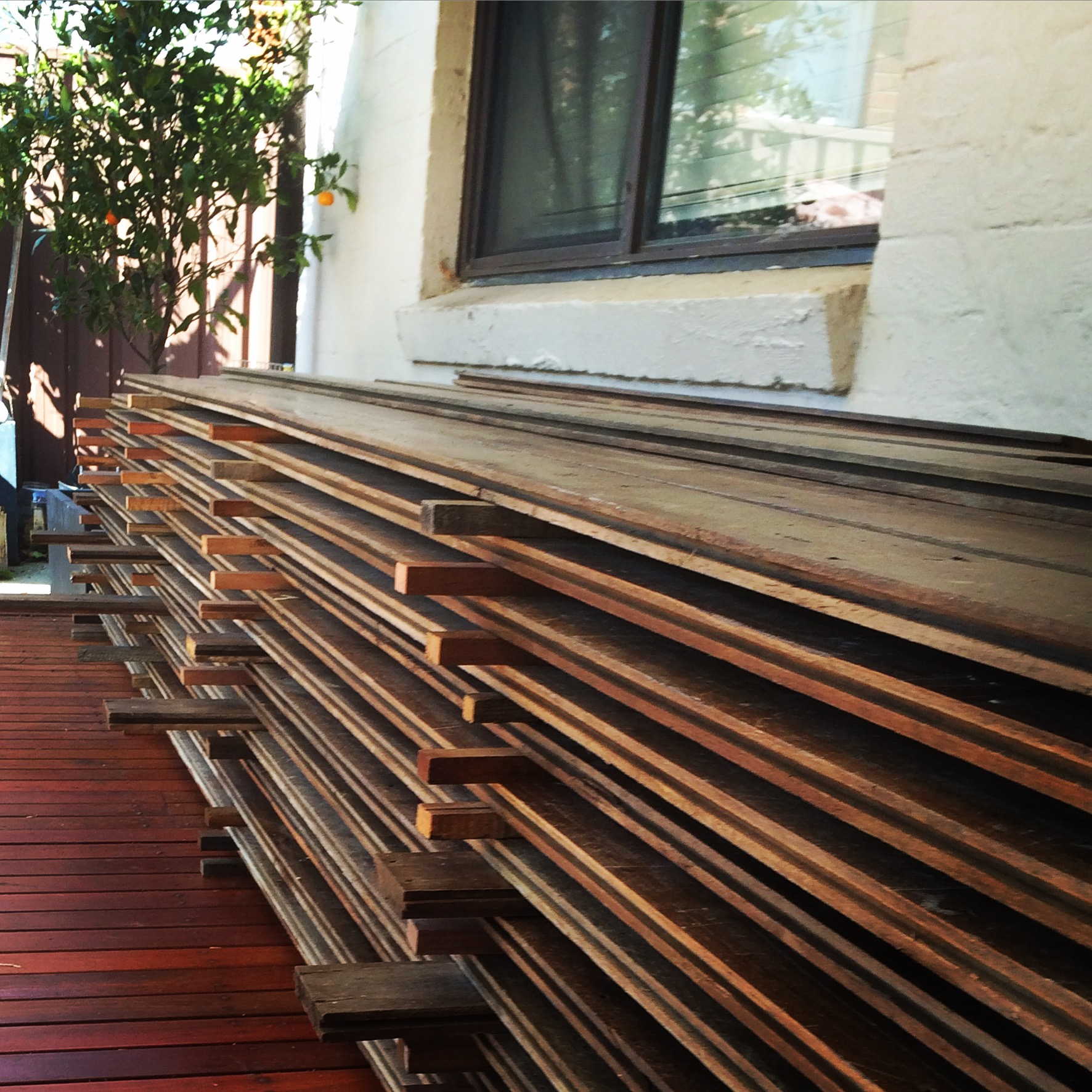 Salvaged Blackbutt boards delivered to the client's house ready to lay!