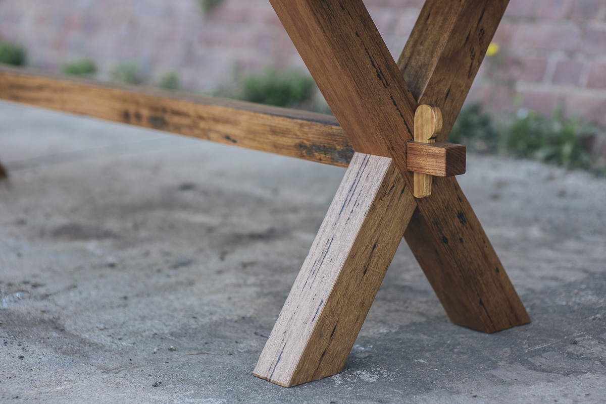 Joinery detail of a wedged mortise and tenon joint on a Thor's Hammer 'X Frame' table.