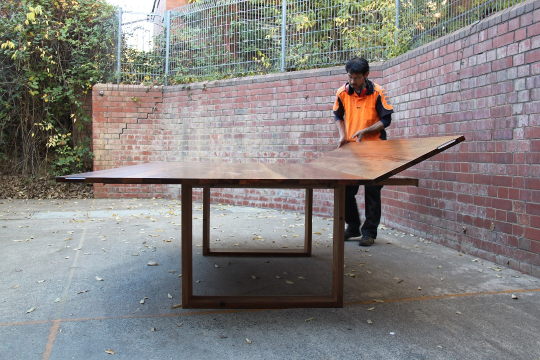 Folding leaf table built in recycled Spotted Gum. Seats 8 when closed or 14 when at full extension.