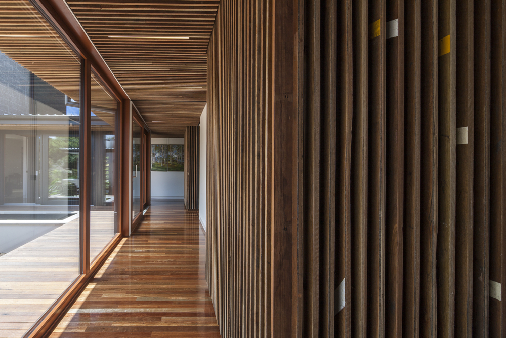 Spotted Gum salvaged from the Bicentenial Baskeball Stadium in Penrith.The wall cladding has been installed with the court line markings left on.