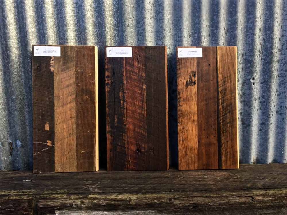Saw tooth floor board samples sanded to three different finish levels
