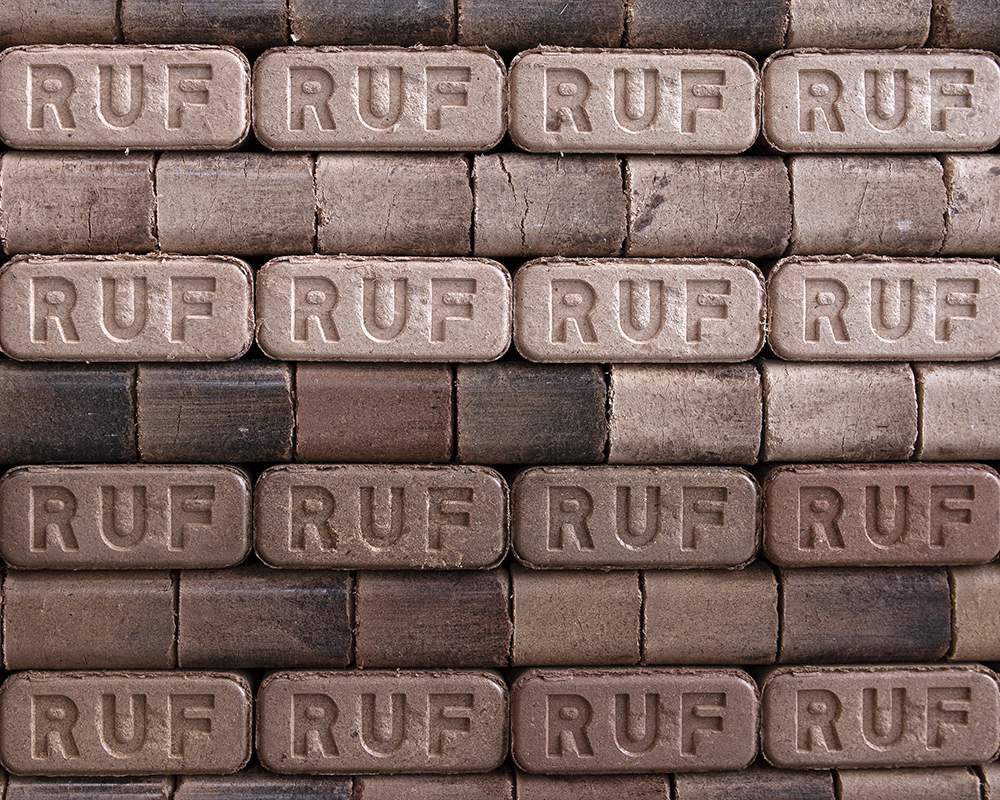Fire briquettes neatly stacked on a pallet.