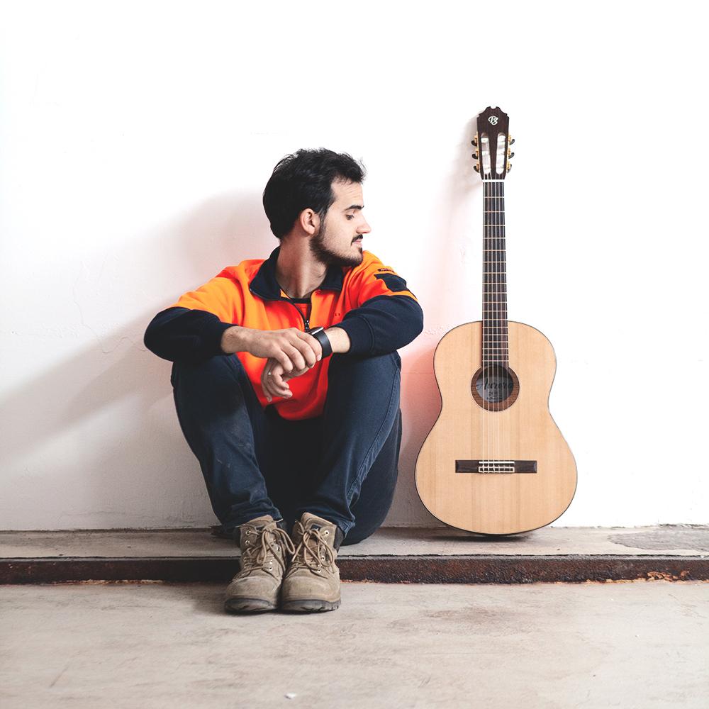 David and his handmade guitar.