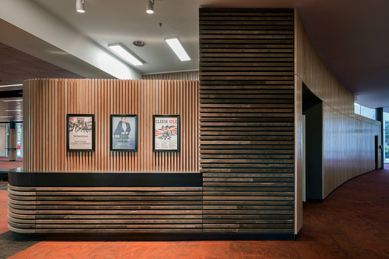 The reception counter at the National Convention Centre designed by  Phillip Leeson Architects . Recycled timber battens in Mixed Ash and Blackbutt.