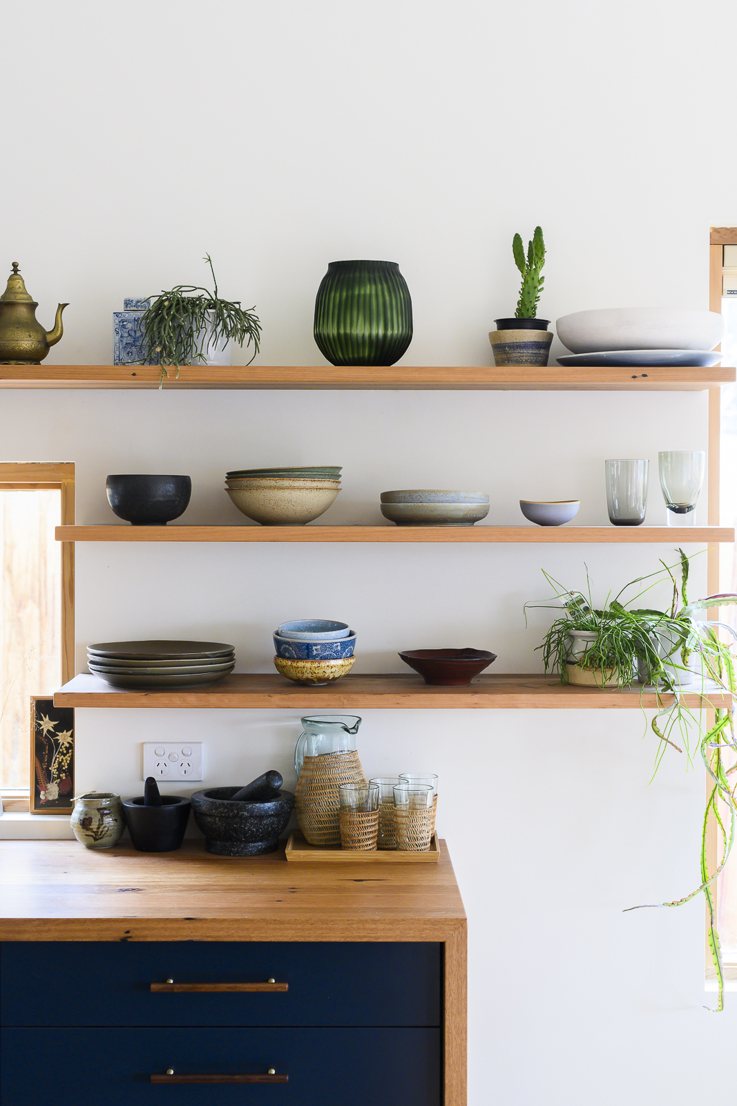 Blackbutt bench top with matching floating shelves above.