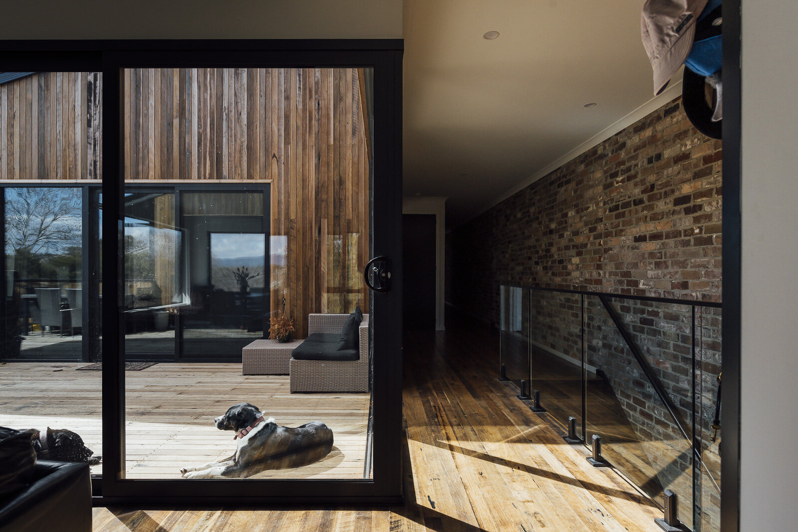 We hoarded quite a collection of recycled Blackbutt to provide for Amy's re-milled floor, deck and interior/exterior cladding. All with a rustic sawtooth finish.
