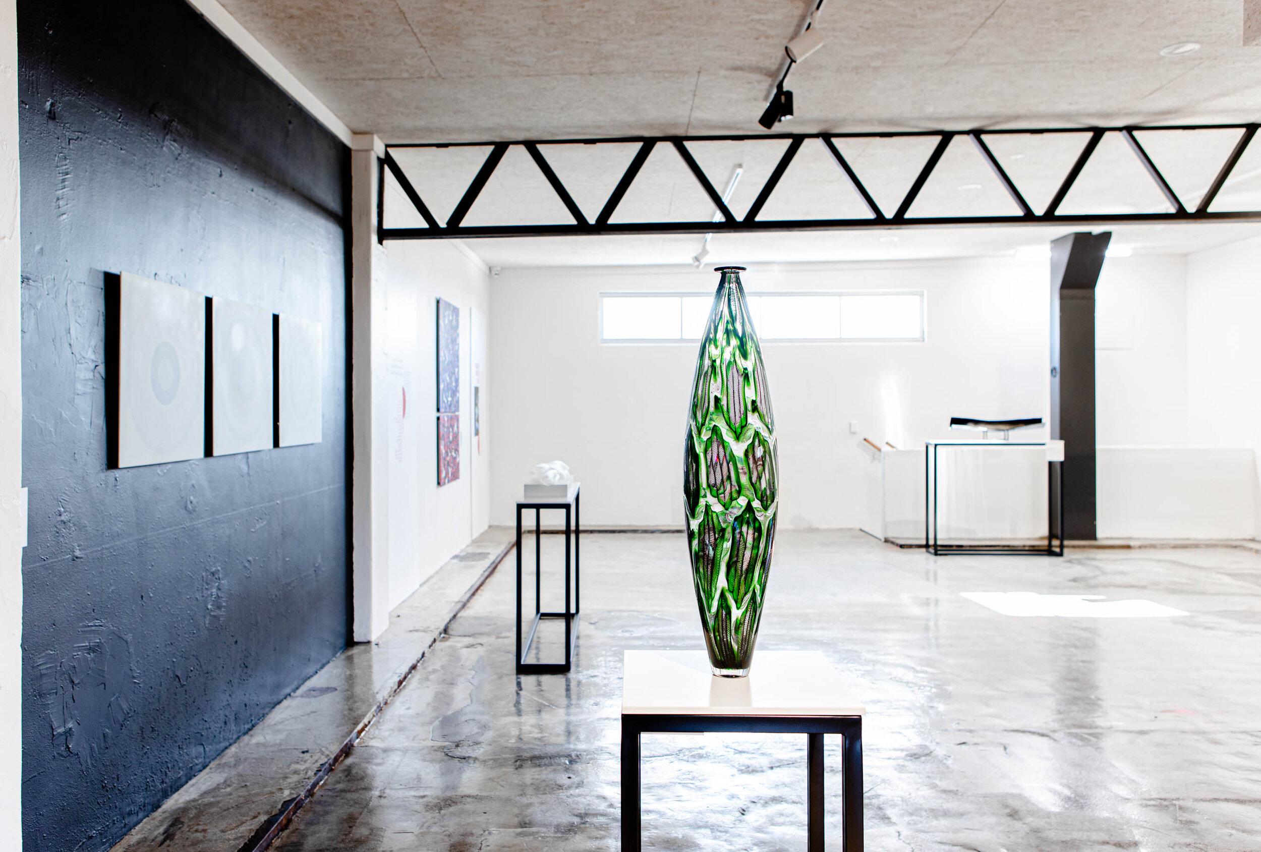 Tom Rowney' s work. Green aventurine motif, with black Zanfirico cane work. Murrini and caneworked blown glass.