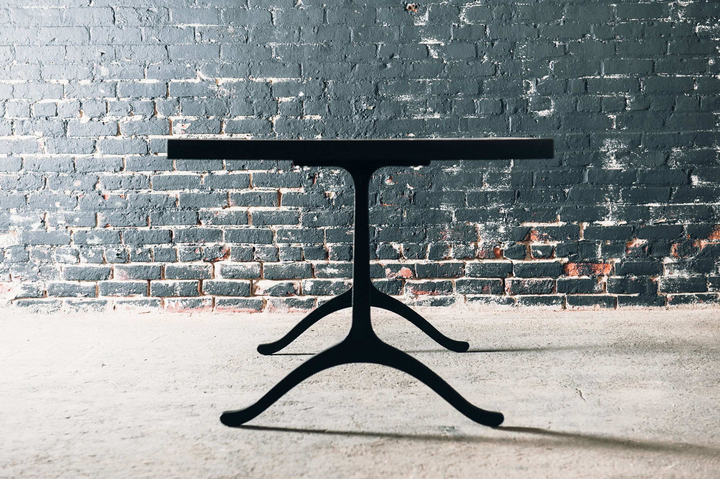 Slab table with cast iron base