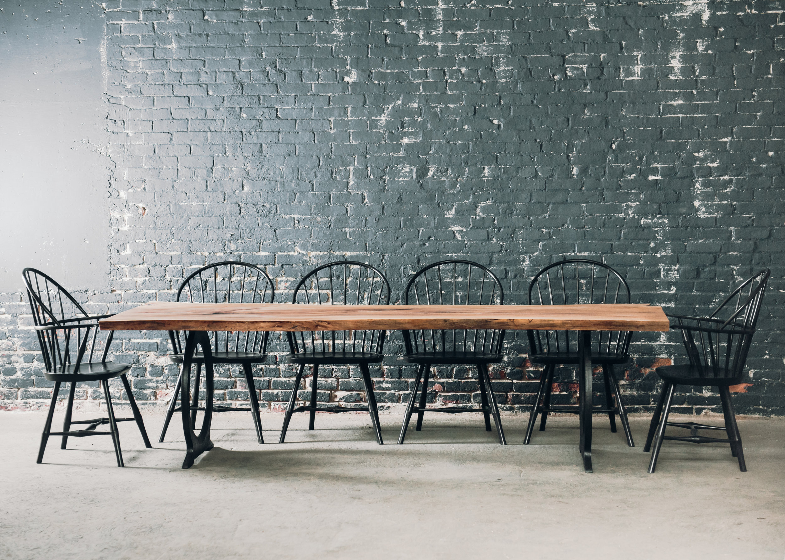 9' Beech Slab Table with Black Omega Base.