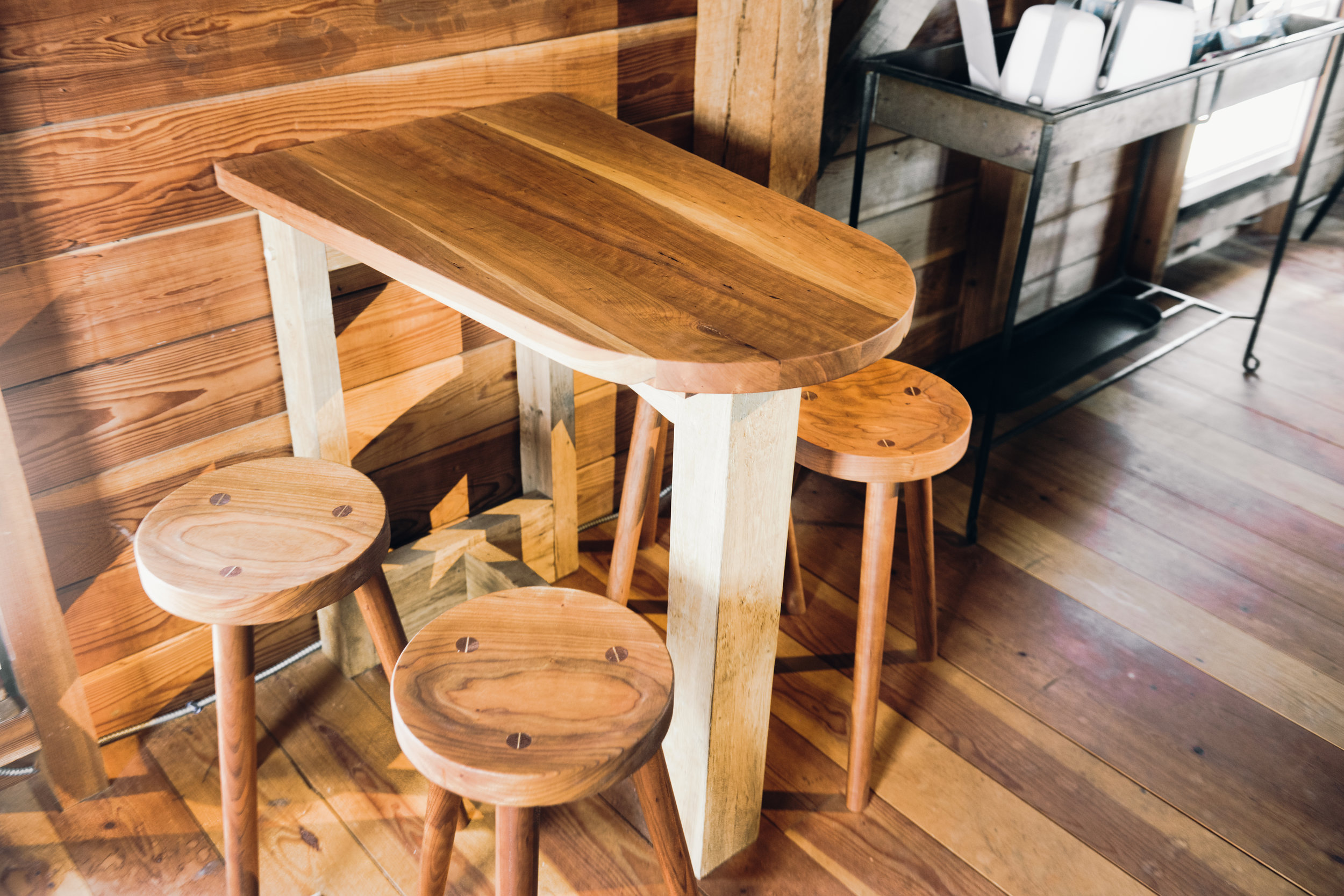 cherry kitchen table with reclaimed wood base and round cherry stools