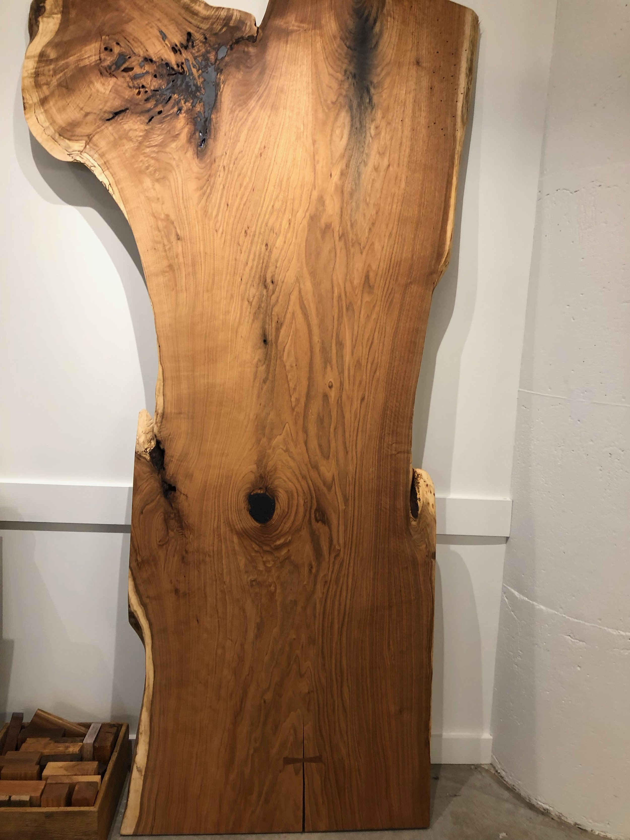 "Single slab butternut that is 8' long x 36"" wide. This piece was finished to show the color and figure but can still be trimmed down to size to fit your space."