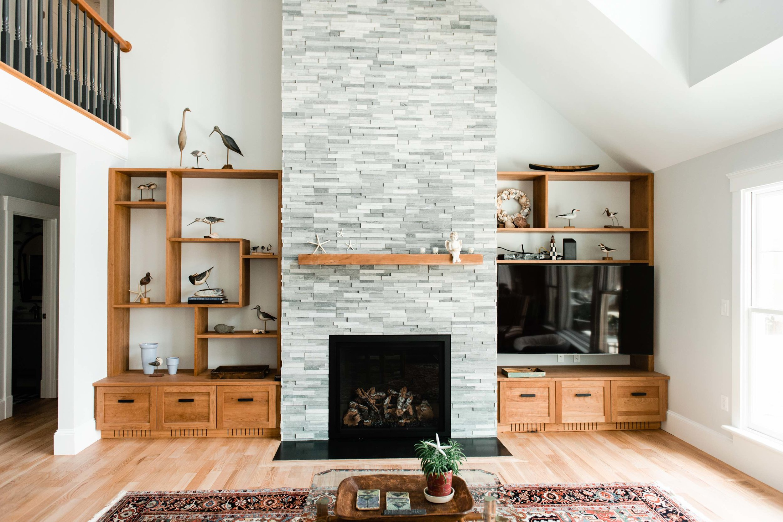 Cherry Built ins and mantle with grey stone fireplace