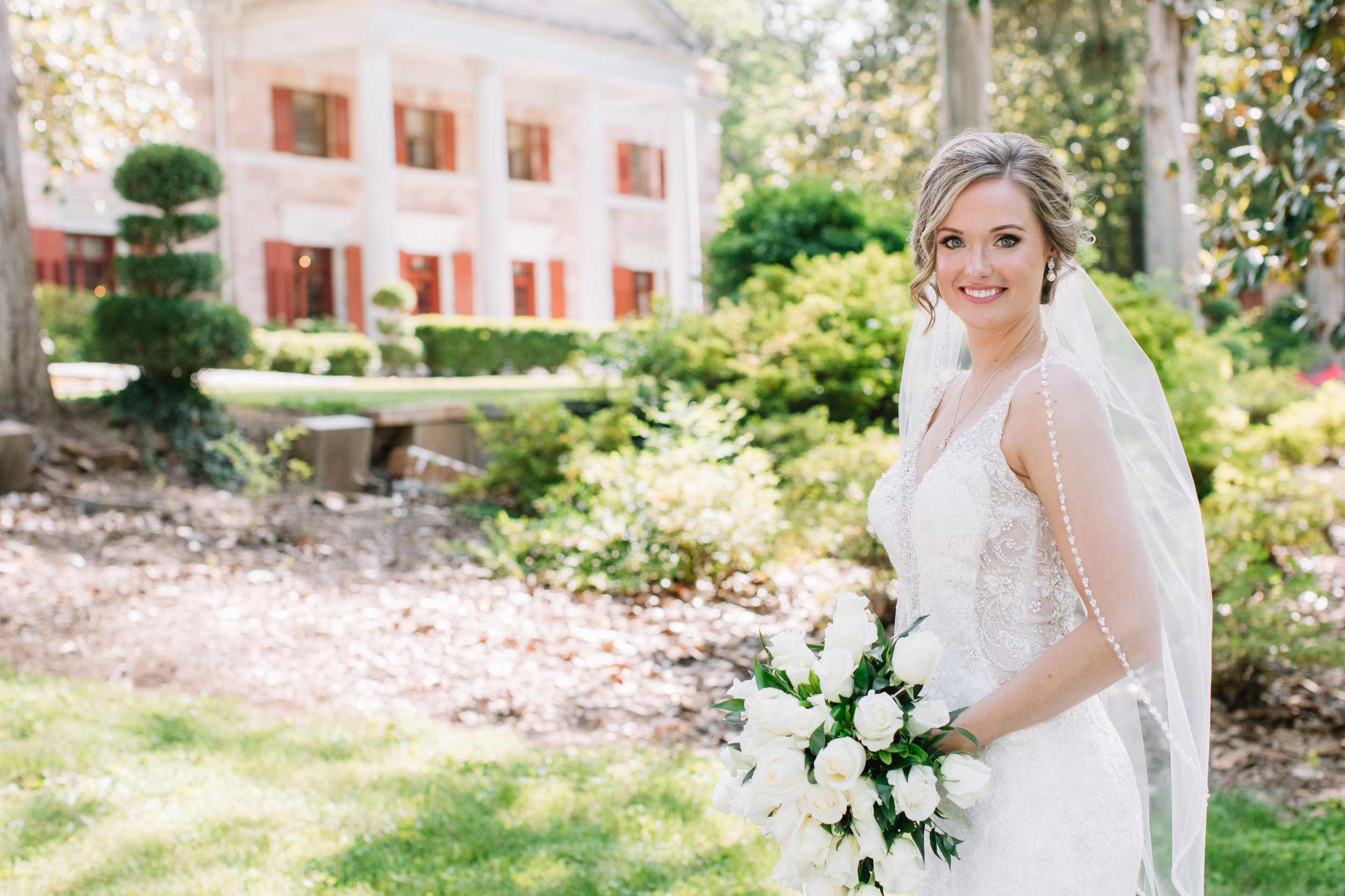 bride in front of tate house