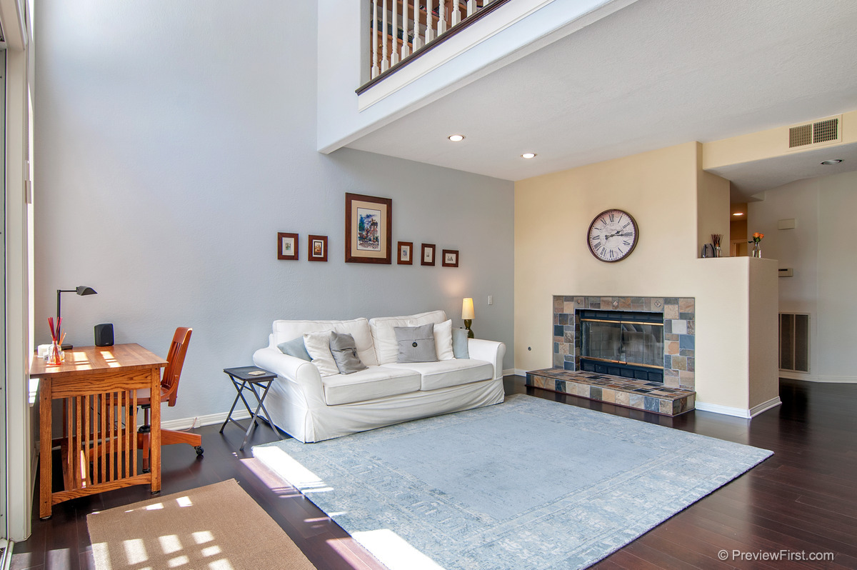 25 - Low Res - Downstairs sitting room fireplace on right white couch in middle.jpg