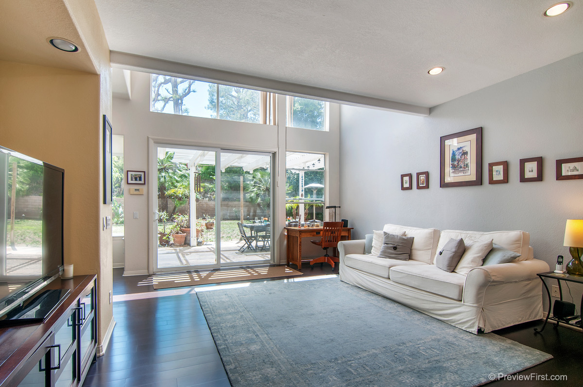 27 - Low Res - Downstairs sitting room white couch on right tv on left.jpg