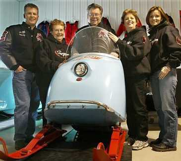 The Harrison family attends several vintage snowmobile rallies each year, clad in their black and red Scorpion gear. From left to right: Randy Harrison, Eileen Harrison, Dick Harrison, Deb Piirainen and Starr Harrison. (Harrison family - Joel Koyama, Star Tribune)