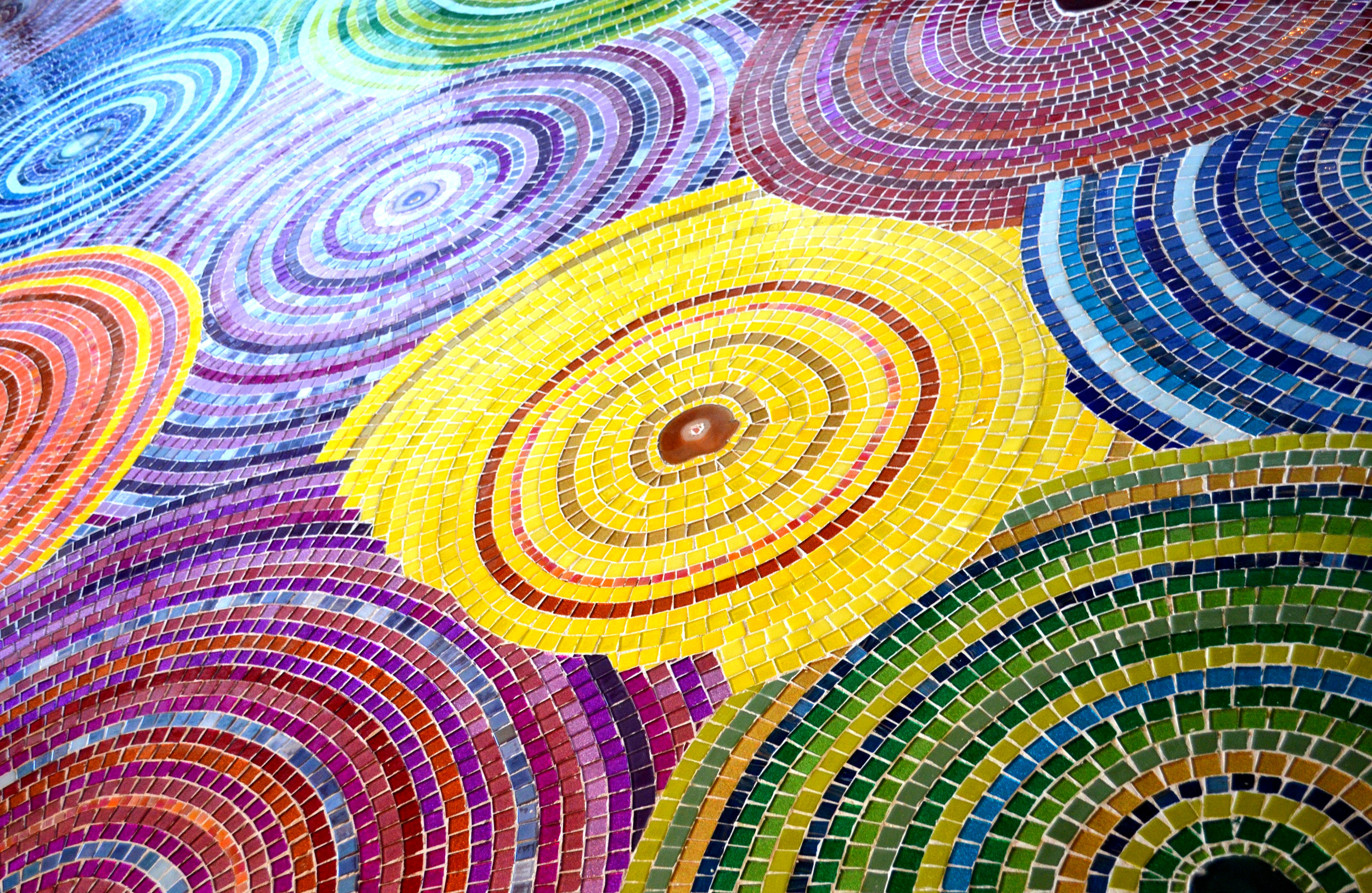 RAINBOW MOSAIC FLOOR using agate crystals and glass tiles at Phia Labs in Denver