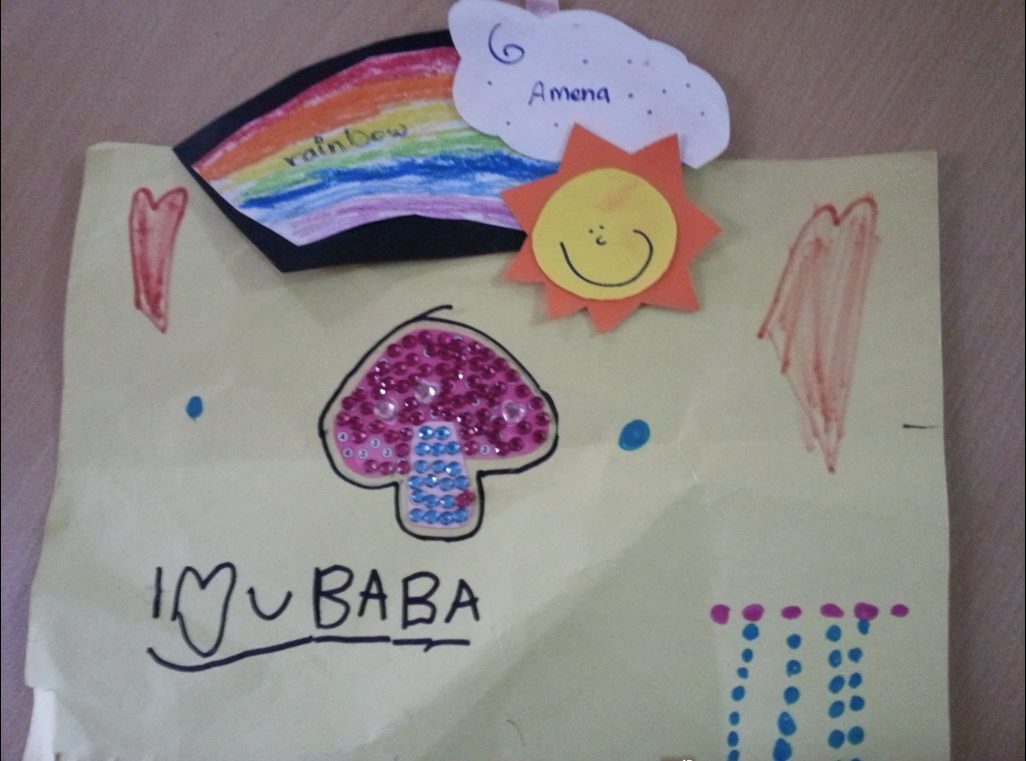 "Khaled's daughter, Amena created this artwork for her father. It says, ""I love you baba."" Khaled's wife informs us that she was unable to deliver it to him because it was drawn on paper. Paper is not allowed into the prison."