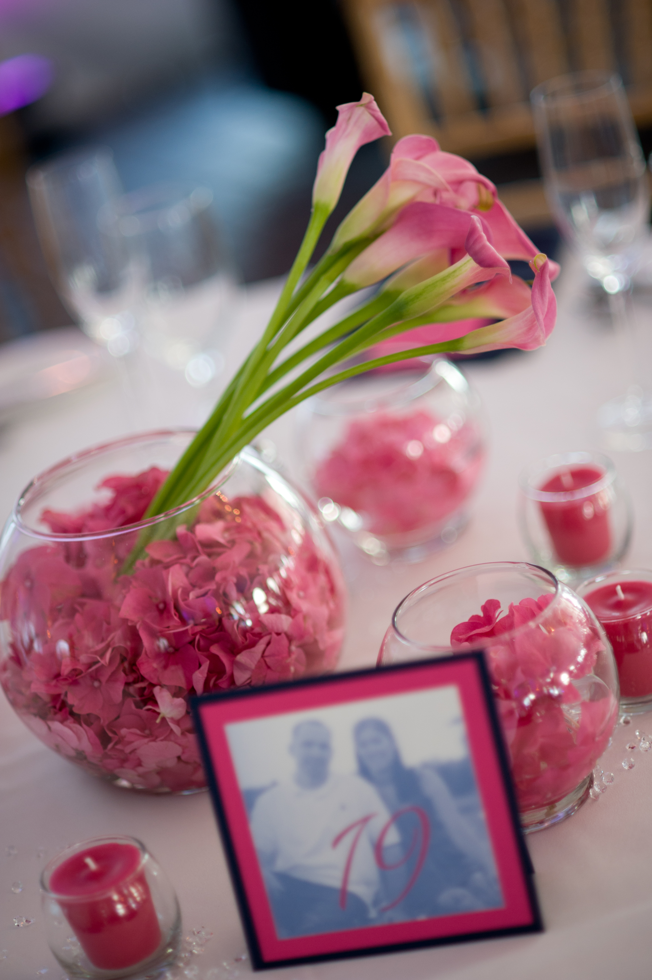 We loved the low pink centerpieces and our signature square photo table numbers!