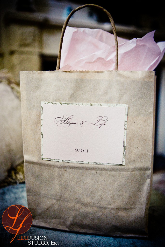 We designed a customized self-sticking label for a simple but elegant ivory gift bag and finished the bag with blush pink tissue paper. This Boston Welcome Bag is perfectly coordinated to the bride's colors and paper goods.