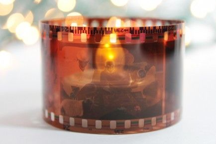 We love the clever film votive candle holders! Just make sure to use battery operated candles so you don't start a fire!
