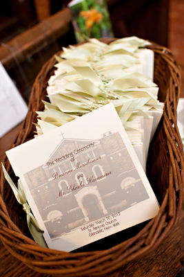 A basket of ceremony prorams with a watermarked image of the church on the front cover.