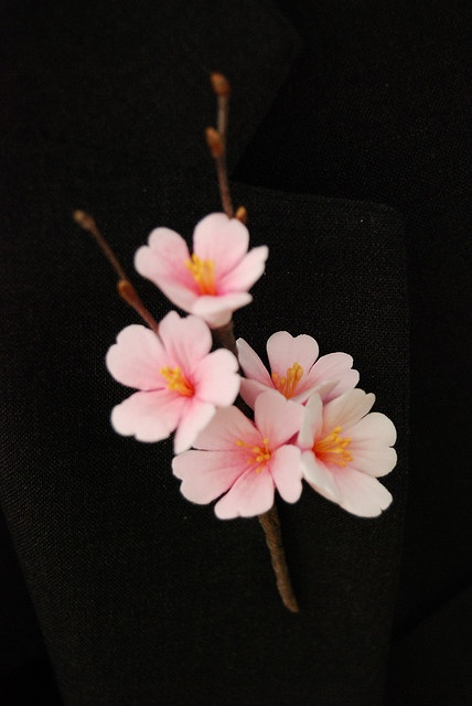 This boutonniere is crafted from polymer clay and beautiful!