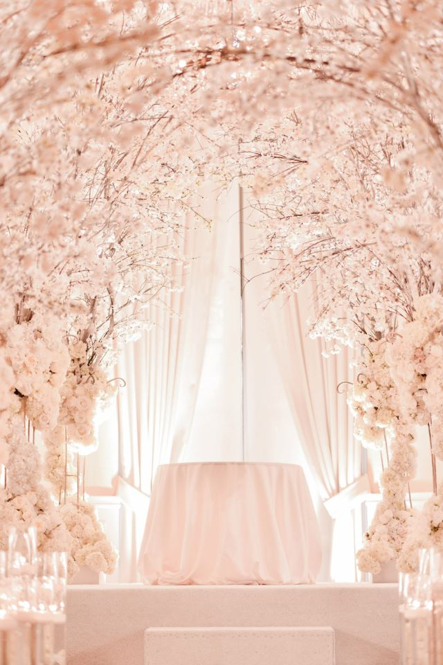 What a vision in spring and pink for a ceremony!
