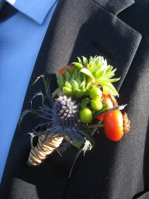 You can have your Boutonnière and eat it too! Well, not exactly as the Thistle will be a little sharp on the tongue but we love the little tomato for the pop of color and extra vitamin C!