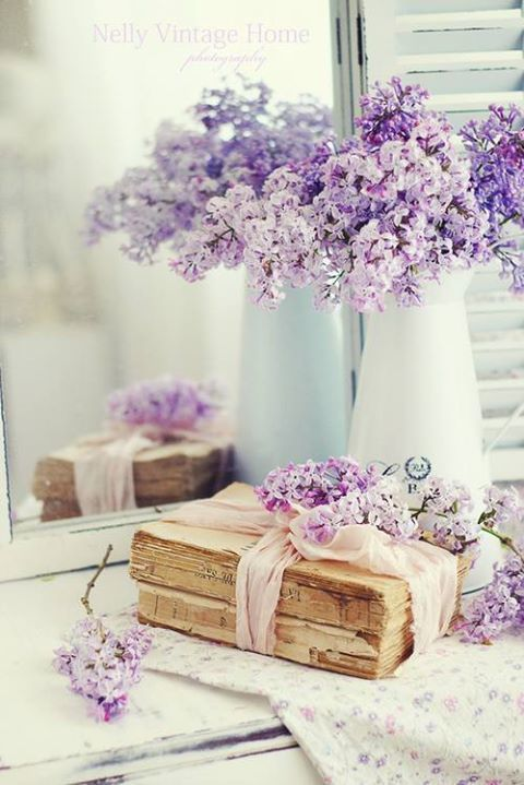 This fabulous Lilac table Display would be great on a welcome table, guest card table or just any lovely table for your wedding!