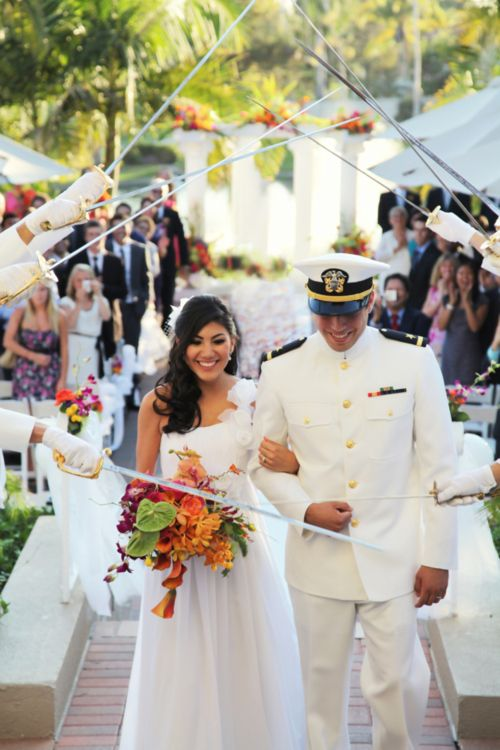 We love this photo of the bride with her colorful bouquet and the Sword Arch!