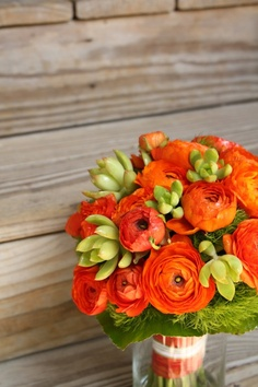 The texture of the rannunculus , the feathery fern and succulents make this bouquet really sing!