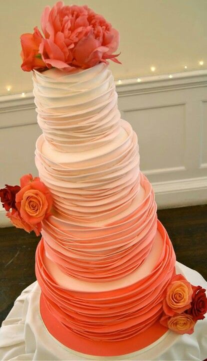 This orange ombre wedding cake is spectacular! We wish we could have a slice of it!