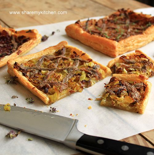 Pissaladière is best described as a focaccia/pizza base with caramelized onions, anchovy and onion. Sometimes cheese is added. It make a tasty appetizer to have with a cocktail!