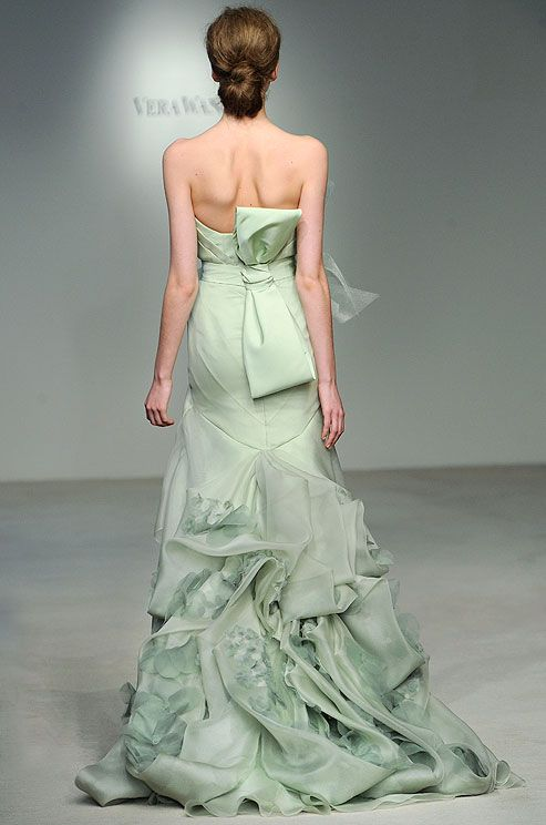 We love the colored gowns that Vera Wang has been featuring and this Mint Green version is no exception! We love the detailing on the back!